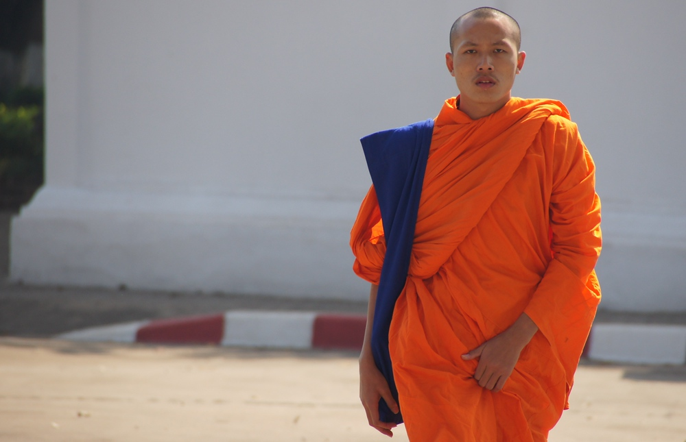 A Laos monk grabbing himself (touching his privates) - Vientiane, Laos.