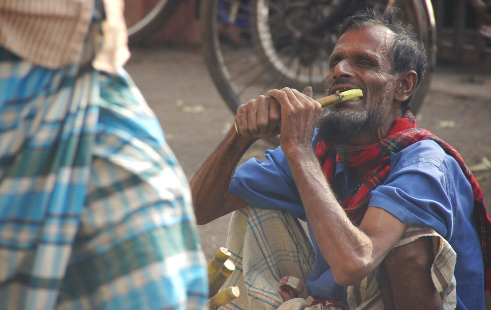 A man chewing on something - Dhaka, Bangladesh.