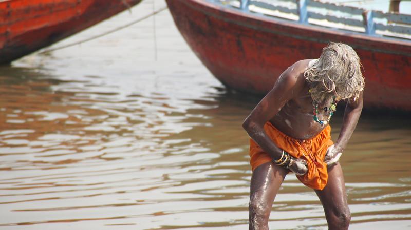A man washing his private parts/genitals in the Ganges - Varanasi, India.