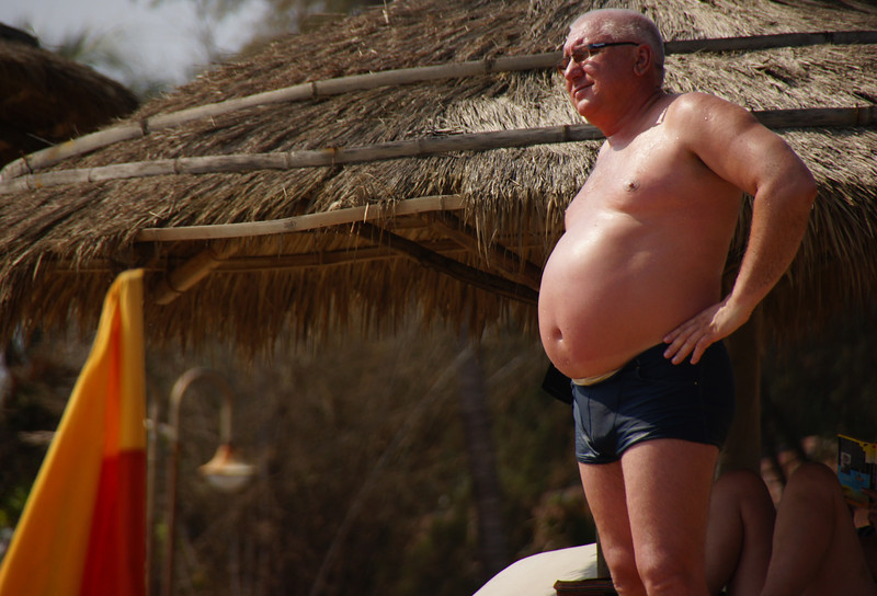 A man flashes his bulbous belly in Nha Trang, Vietnam.