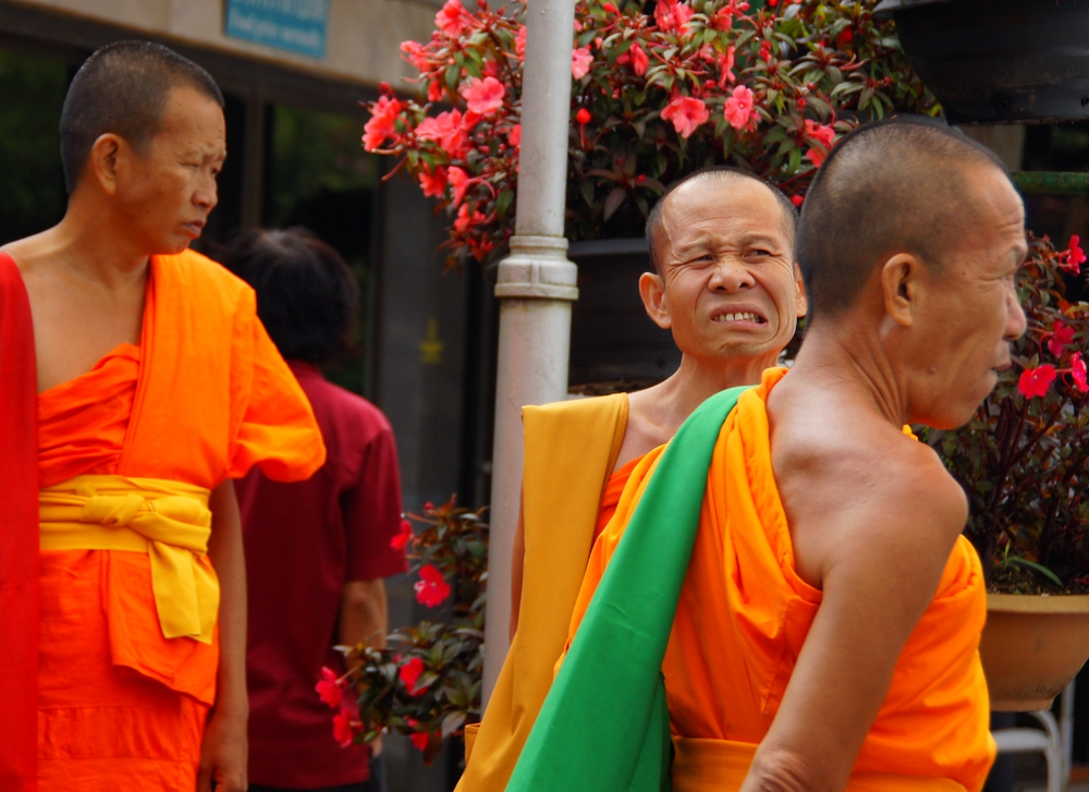 A Thai monk making a strange, silly, bizarre face - Chiang Mai, Thailand.