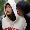 A Korean couple embrace with a hug on the street of Insadong - Seoul, South Korea