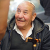 An elderly man flashes a smile as he's greeted by friends at the Mahane Yehuda Market in Jerusalem, Israel.