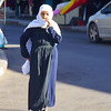 A Druze elderly lady, wearing traditional attire, walks down the street in Haifa, Israel.