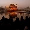 This group of people marvels at the Harmandir Sahib from a distance.