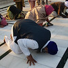 Devotees pay their respect by bowing in servitude.