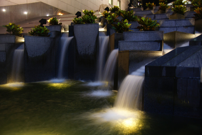 A slow shutter speed photo of flowing water at night - Hong Kong Island, China.