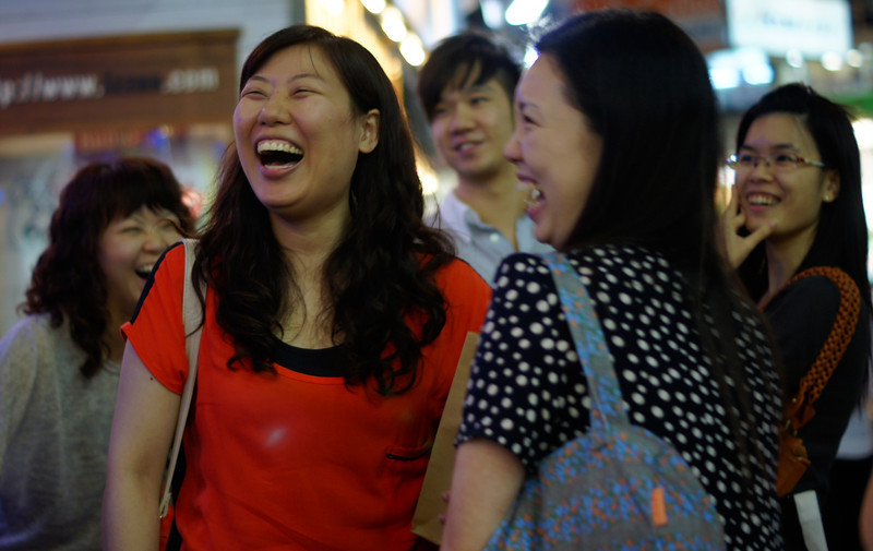 A group of ladies laughing hysterically in Hong Kong, China.