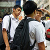 A group of teenage boys waiting to catch a bus - Hong Kong, China
