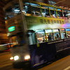 A motion blurred photo of the tram at night - Hong Kong Island, China.