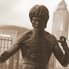 The imposing Bruce Lee statue looms large over the Avenue of Stars walkway in Hong Kong, China.
