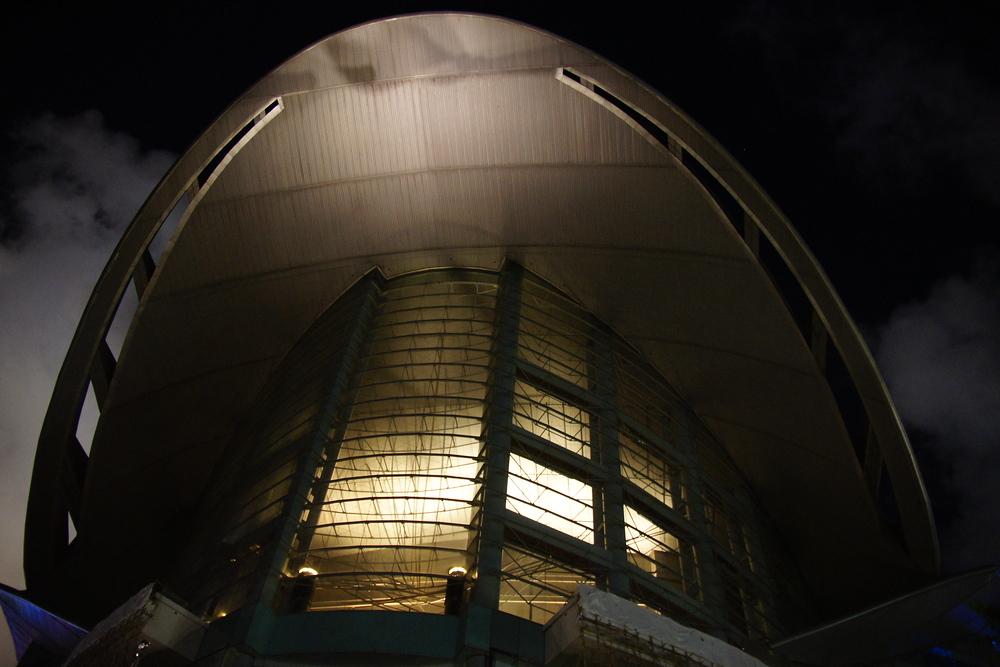 Large building illuminated at night in Hong Kong, China