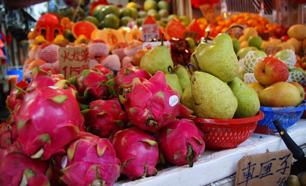 Fresh exotic looking fruits being sold at a local market - Hong Kong, China.