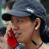 A lady talking on her cellphone - Hong Kong, China.