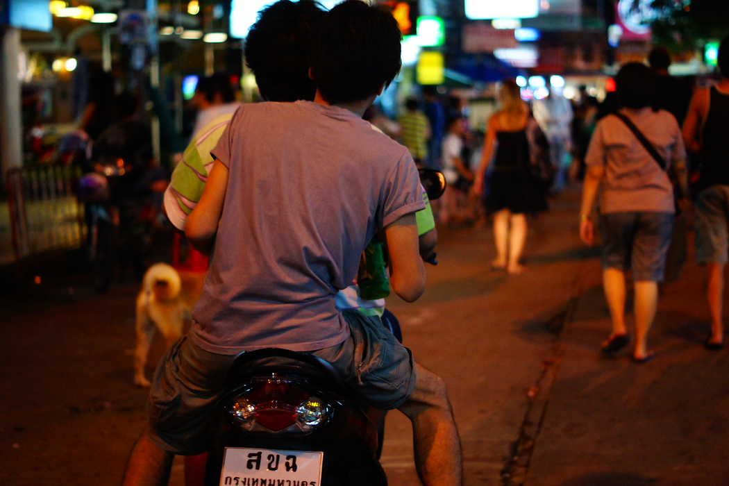 http://nomadicsamuel.com : A couple of men dump on a motorbike to scurry off somewhere else.