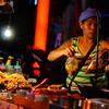 "<a href=""http://nomadicsamuel.com"">http://nomadicsamuel.com</a> : A Thai lady vendor prepares packages of curry and soup."