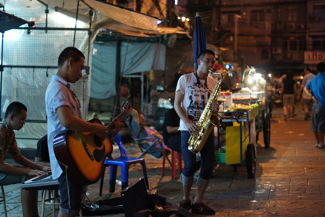 http://nomadicsamuel.com : Street musicians perform with hopes of receiving a few Baht.