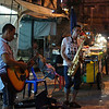 "<a href=""http://nomadicsamuel.com"">http://nomadicsamuel.com</a> : Street musicians perform with hopes of receiving a few Baht."