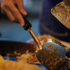 "<a href=""http://nomadicsamuel.com"">http://nomadicsamuel.com</a> : The scraping of utensils as a man fries Pad Thai."
