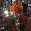"<a href=""http://nomadicsamuel.com"">http://nomadicsamuel.com</a> : A mobile street vendor pushes a cart down Khao San Road."