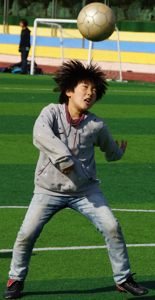 This Korean boy turned out to be the most photogenic of the entire group. In this shot he's just made a header.