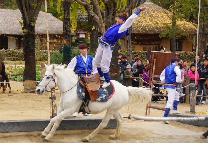 This young Korean boy was definitely one of the stars of the show.  Here he is pretending to be falling off of the horse as it races around the ring.