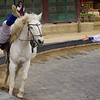 This Korean equestrian rider is attempting to grab the cloth placed on the perimeter of the ring.  Do you think he grabbed it or not? :P