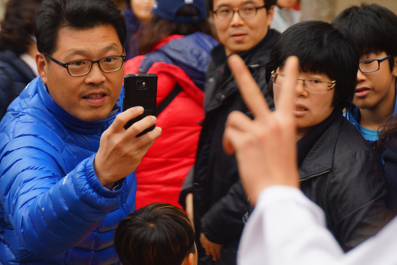 Taking photos with camera phones is all the rage in Korea these days.  Actually, what's just as common are photos with tablets and ipads.