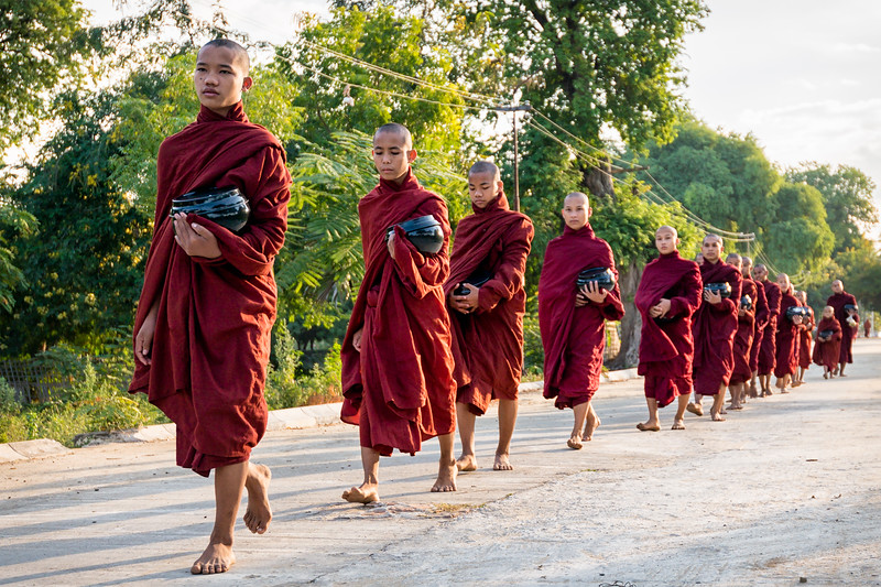 Monks in formation for breakfast in Mingun