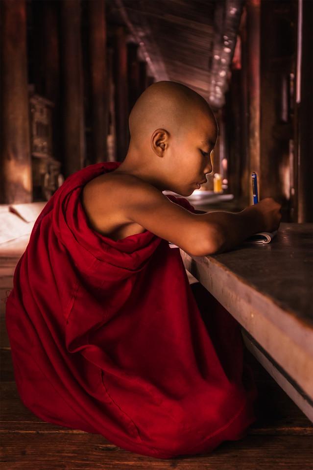 Monk doing his lessons at Bagaya Monastery at Inwa