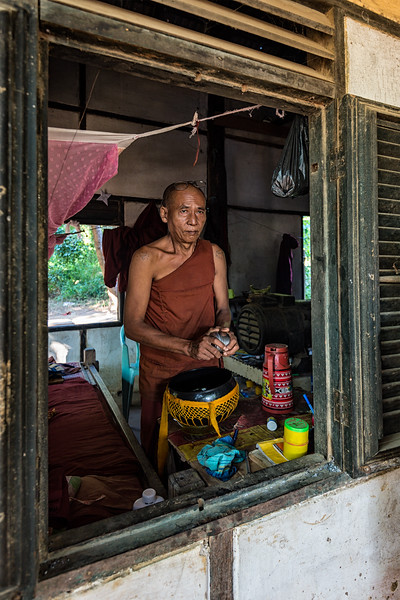 Elder monk preparing lunch for the house near Hsinbyume Pagoda