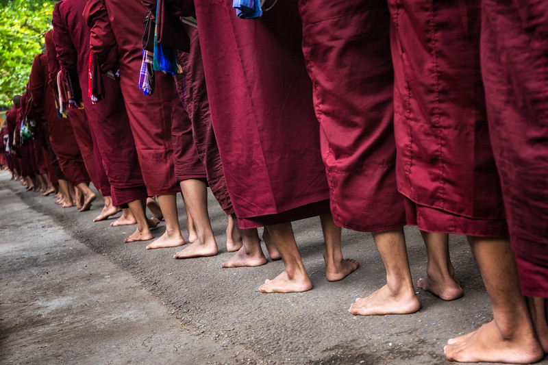 Monks wait in line to receive lunch in Bagan. Similar to my experience in the military, their life is full of waiting in lines.