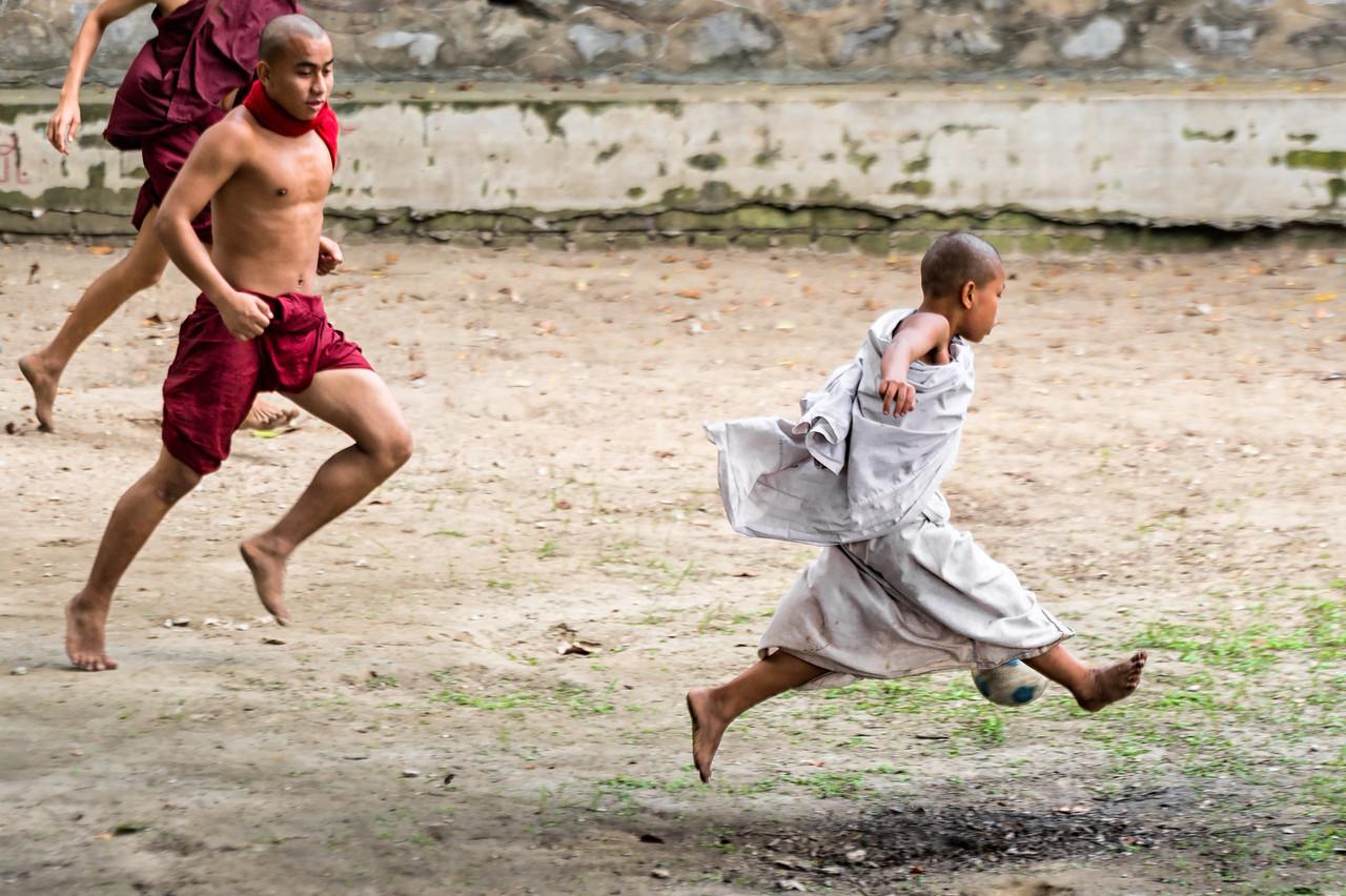 Monks enjoying a soccer match in Mandalay, near U Bein Bridge