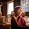 Young monk with playful attitude at Bagaya Monastery