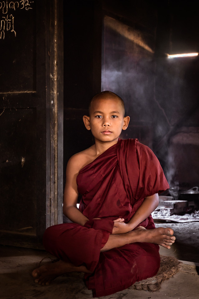 Young monk relaxing at his quarters near Hsinbyume Pagoda in Mingun