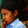 A cute Ecuadorian girl picks here nose - Quito, Ecuador