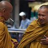 A Khmer Buddhist monk smokes a cigarette in Battambang, Cambodia.