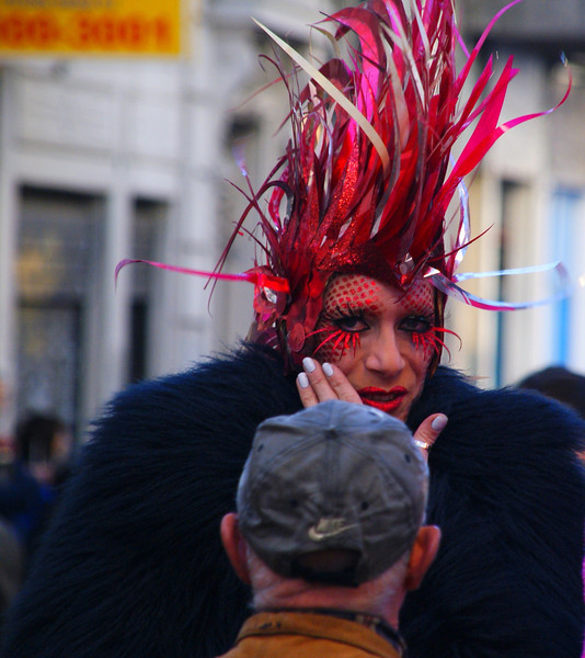 A drag queen in Buenos Aires whispers into the man's ear while staring at me - Buenos Aires, Argentina