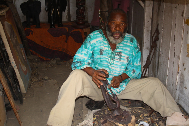 "A wood carver at a market in Arusha:  <a href=""http://nomadicsamuel.com/photo-essays/the-people-of-tanzania"">http://nomadicsamuel.com/photo-essays/the-people-of-tanzania</a>"