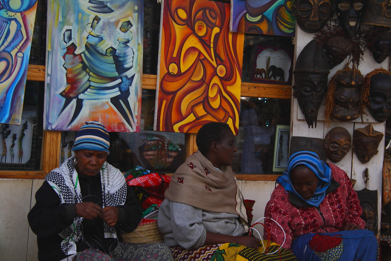 """Women making bead bracelets and necklaces at a market in Arusha:<br /> <a href=""""http://nomadicsamuel.com/photo-essays/the-people-of-tanzania"""">http://nomadicsamuel.com/photo-essays/the-people-of-tanzania</a>"""