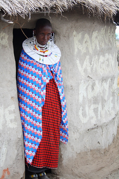 "A Masai woman stands in her doorway before inviting me into her house in a village at Lake Manyara:  <a href=""http://nomadicsamuel.com/photo-essays/the-people-of-tanzania"">http://nomadicsamuel.com/photo-essays/the-people-of-tanzania</a>"