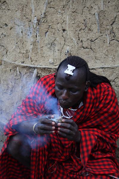 """A Masai Warrior demonstrates how to create fire using donkey dung in his village at Lake Manyara:  <a href=""""http://nomadicsamuel.com/photo-essays/the-people-of-tanzania"""">http://nomadicsamuel.com/photo-essays/the-people-of-tanzania</a>"""