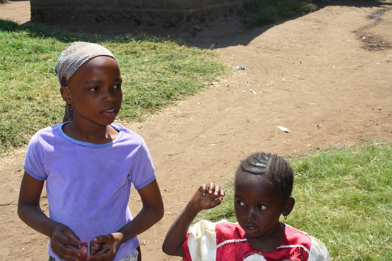"Two girls come to greet me in Mto wa Mbu:  <a href=""http://nomadicsamuel.com/photo-essays/the-people-of-tanzania"">http://nomadicsamuel.com/photo-essays/the-people-of-tanzania</a>"