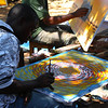 "A tinga tinga artist painting in Mto wa Mbu - Tanzania, Africa:  <a href=""http://nomadicsamuel.com/photo-essays/the-people-of-tanzania"">http://nomadicsamuel.com/photo-essays/the-people-of-tanzania</a>"