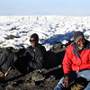 "Two trekking guides take a rest at Uhuru Peak on the summit of Mount Kilimanjaro (Altitude: 5895m):  <a href=""http://nomadicsamuel.com/photo-essays/the-people-of-tanzania"">http://nomadicsamuel.com/photo-essays/the-people-of-tanzania</a>"