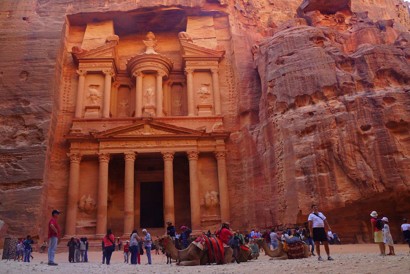 This is the iconic image from Petra, Jordan - a wide angle perspective shot of the treasury.  You won't have this place to yourself though as hoards of tourists, camels and even cats all compete for space.
