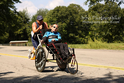Team Hoyt is a father (Dick Hoyt) and son (Rick Hoyt) team from Holland, Massachusetts who have competed together in various athletic endeavors, including marathons and triathlons. Rick has cerebral palsy and during competition Dick pulls Rick in a special boat as they swim, carries him in a special seat in the front of a bicycle, and pushes him in a special wheelchair as they run. Team Hoyt was inducted to the Ironman Hall of Fame in 2008.