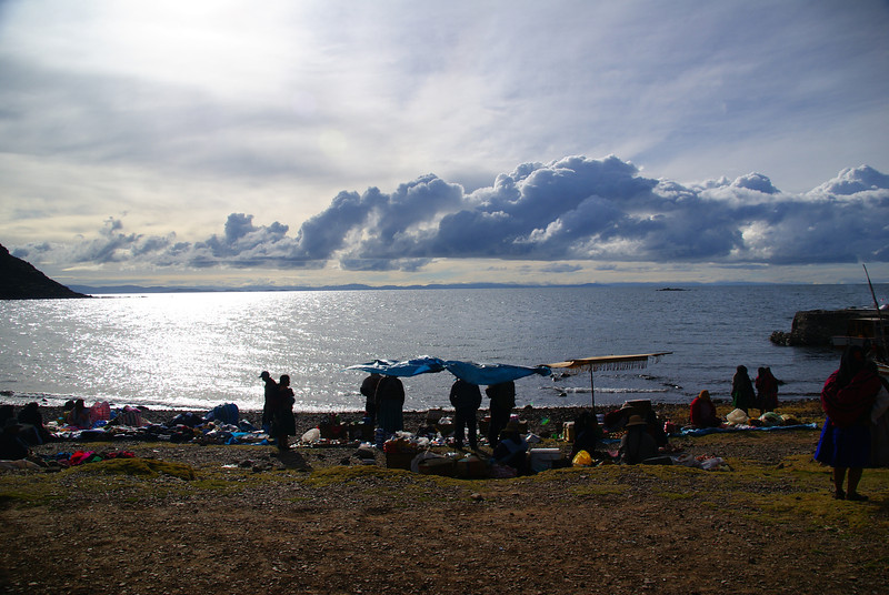 "A wide angle shot of locals setting up their stalls overlooking pristine Lake Titicaca:<br /> <a href=""http://nomadicsamuel.com/photo-essays/lake-titicaca-uros-puno-peru"">http://nomadicsamuel.com/photo-essays/lake-titicaca-uros-puno-peru</a>"