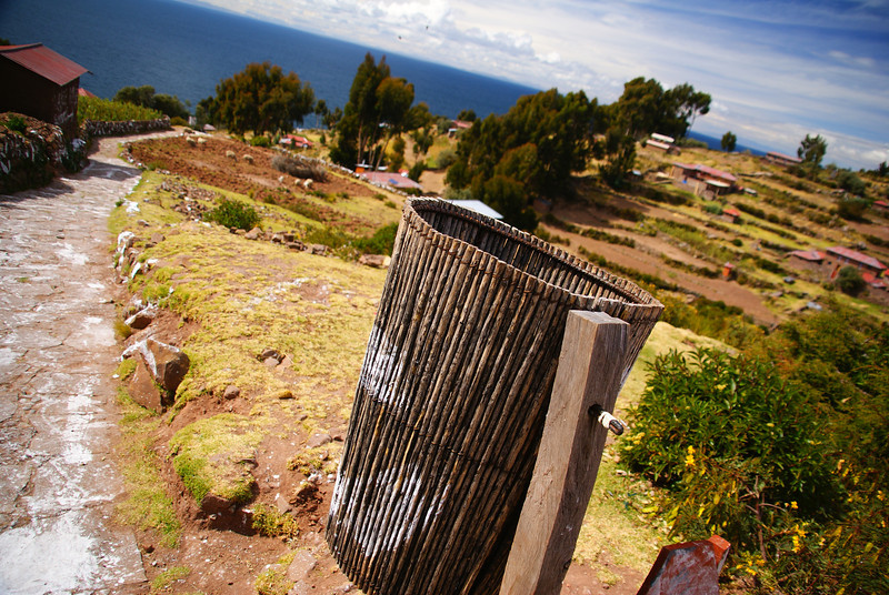 "A waste basket made out of wood frames this shot of the island:  <a href=""http://nomadicsamuel.com/photo-essays/lake-titicaca-uros-puno-peru"">http://nomadicsamuel.com/photo-essays/lake-titicaca-uros-puno-peru</a>"
