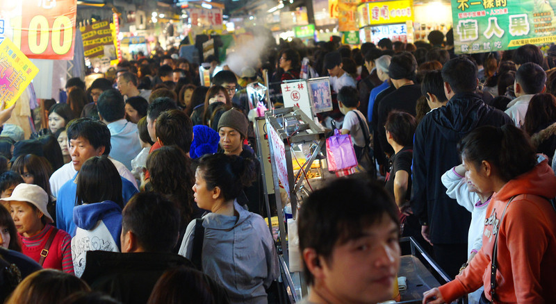 A shot of the crowd passing through the Shilin Night Market.